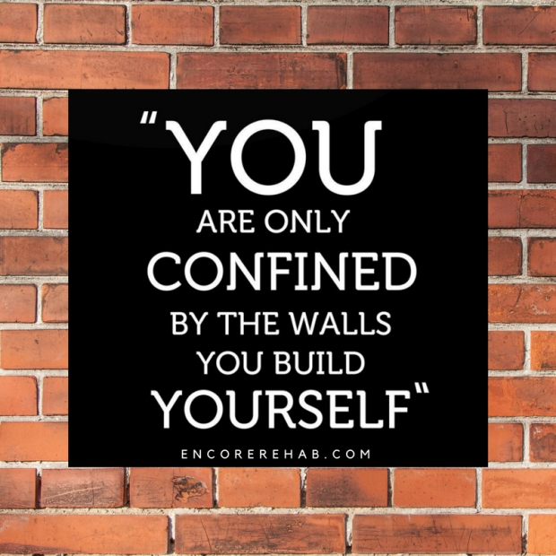 You are only confined by the walls you build yourself on black background on top of brick background. Encore Rehab dot com