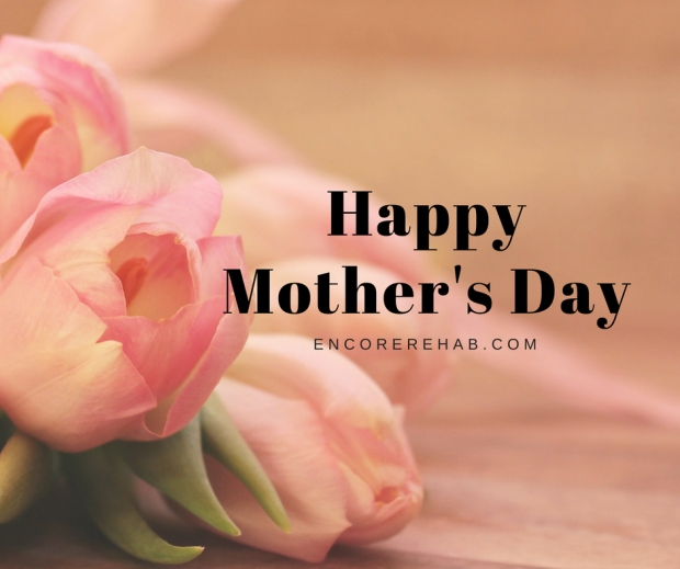 pink tulips in background with Happy Mother's day, encorerehab.com written on the graphic