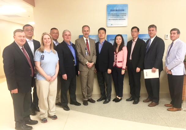 Group posing for photo inside the lobby of Ocean Springs Hospital, Ocean Springs, Mississippi