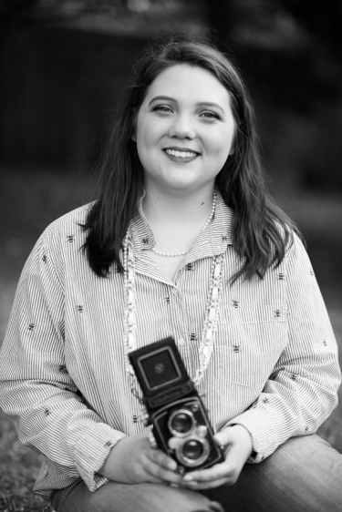 black and white photos of a smiling teenaged girl holding a brownie camera