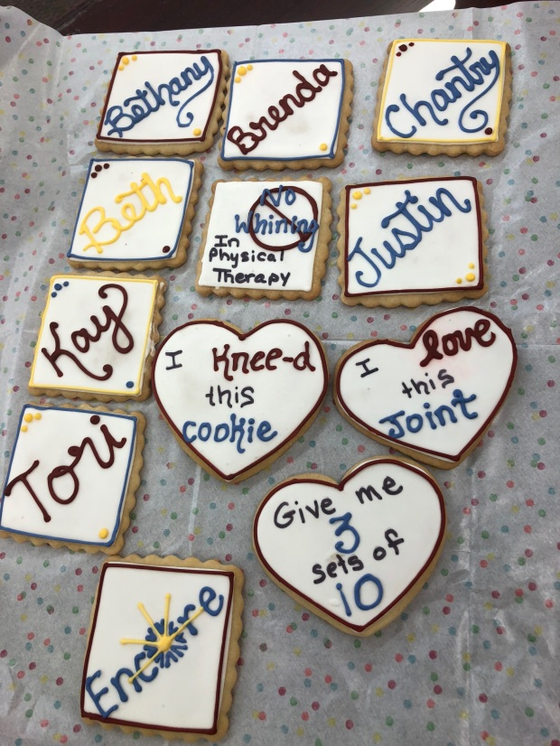 Cookies with frosting and also words, mosty names and the Encore Rehabilitation logo