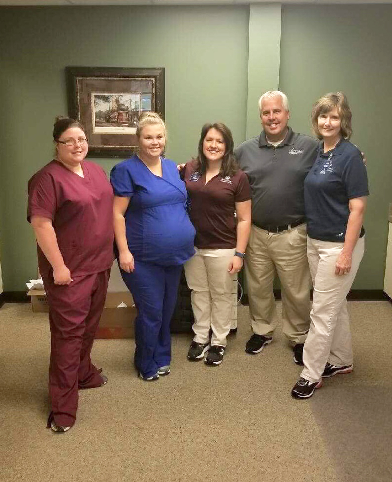 Five Encore Rehabilitation staff members of East Central Physical Therapy, Hurley, Mississippi posing for photo