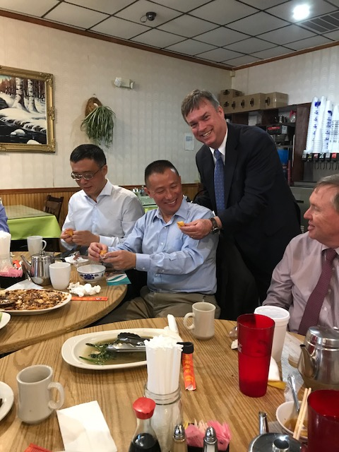 American and Chinese business mean enjoying a meal at a restaurant