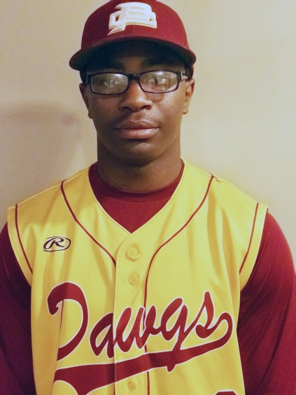 Teenage athlete in baseball uniform that says Dawgs on the shirt