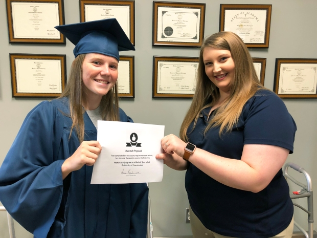 "Athlete of the Month Hannah Popwell receiving her ""Honorary Degree as Rehab Specialist"" from Encore Rehabilitation-Dothan's Summer Reynolds, LPTA"