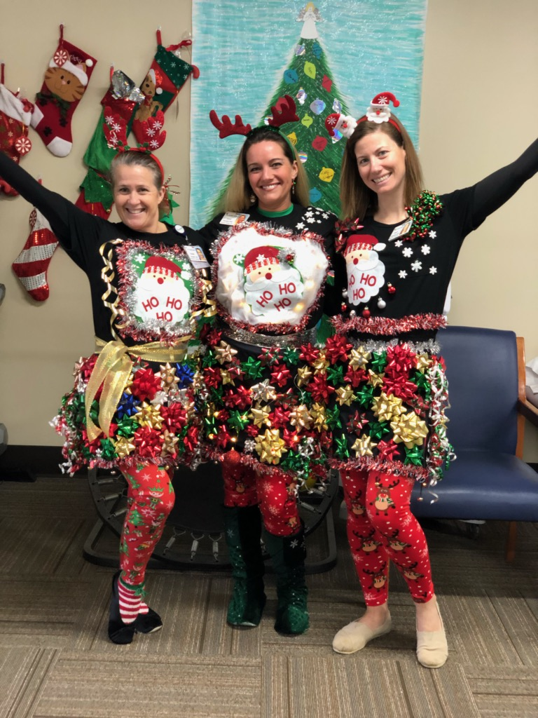 """Encore Rehabilitation Therapists Susan, Jamie, and Hope prepare to compete in the """"ugly sweater"""" contest at Andalusia Physical Therapy #EncoreRehab"""
