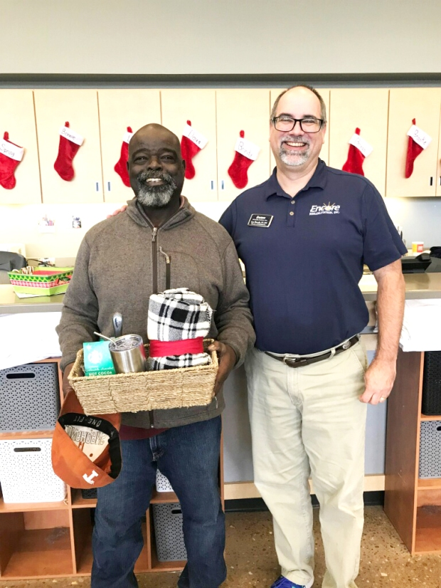 Berkley Smith is the December winner of our gift basket! He is shown here with Clinic Director Lee Borcik, PT, ATC. #EncoreRehab