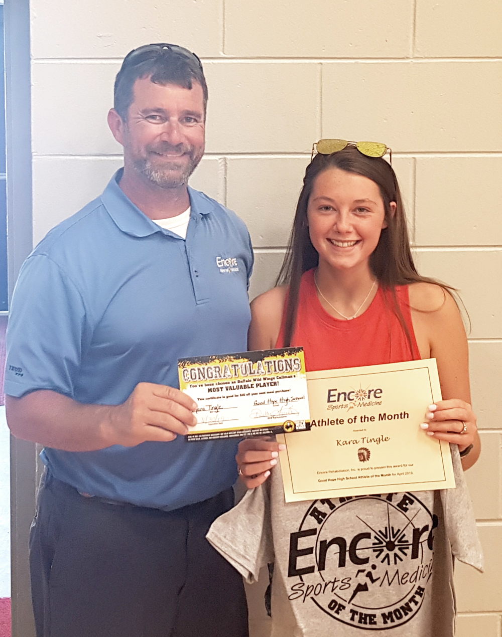 Kara Tingle, multi-sport athlete, is Athlete of the Month for Good Hope High School and Encore Rehabilitation-Culllman. She is pictured here with Encore Sports Medicine Athletic Trainer Bo Shirey. #EncoreRehab