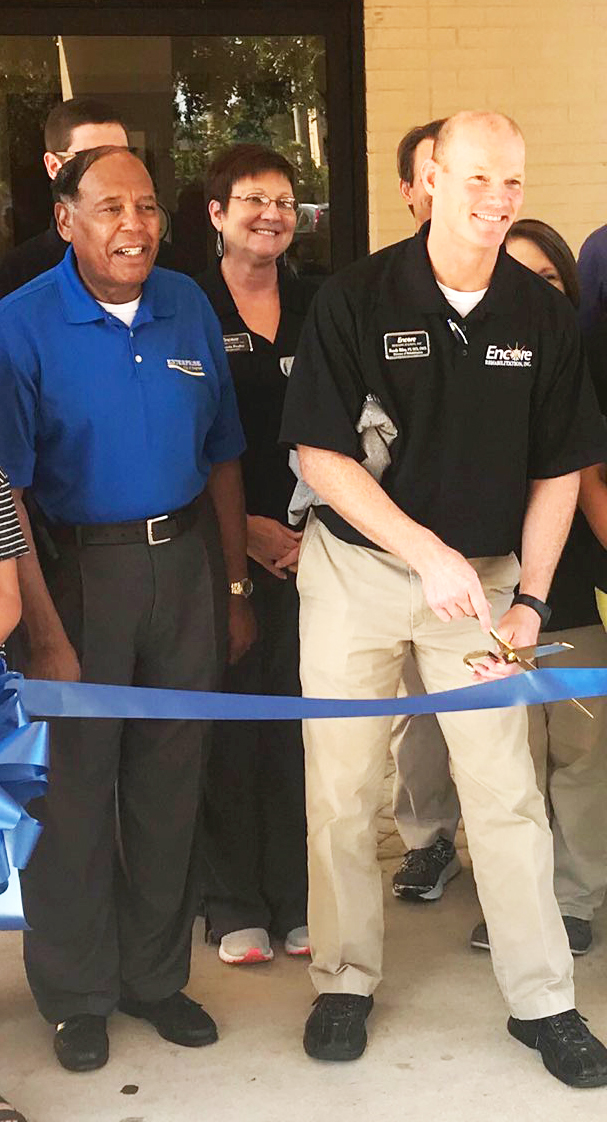 Mayor Bill Cooper and Clinic Director Randy Riley at cutting the Ribbon at Encore Rehabilitation-Enterprise