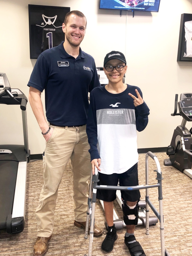 Patient of the Month Pedro Perez is smiling with Clinic Director and Physical Therapist Dylan Heartsill