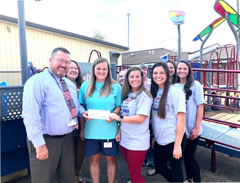 Encore Rehabilitation-Cullman presents a check to the Cullman County Child Development Center towards the construction of a new playground. #EncoreRehab