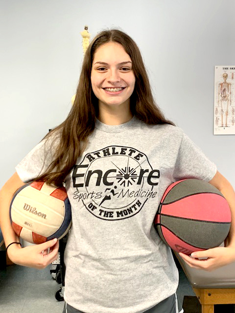 Nina Wedgeworth poses in here Athlete of the Month t-shirt from #EncoreRehab Diamondhead